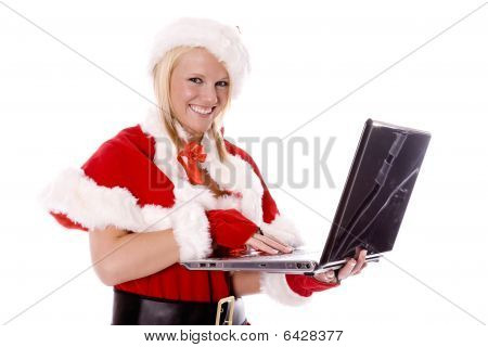 Santas Helper Making List On Computer And Smiling