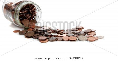 A Spilt Jar Of Change On White