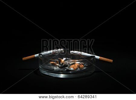 Ashtray And Two Cigarette