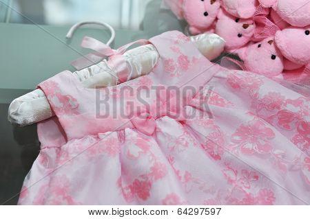 Bow Belt Elegant Children's Dresses On Hangers Close Up.