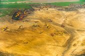 picture of wheel loader  - Wheel loader Excavator unloading sand tractors and dump truck inside construction site - JPG