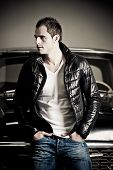 foto of rebel  - Portrait of a rebel type guy in classic leather jacket - JPG