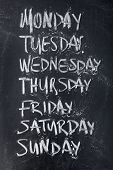 picture of weekdays  - Conceptual weekdays list written on black chalkboard blackboard - JPG