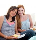 Young Girls Eating Burgers And Fries