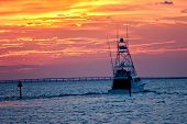 stock photo of gulf mexico  - Large fishing boat going out for sunset cruise in Destin Florida - JPG