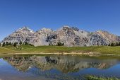 image of melchior  - Le Rois Mages (Baltazar 3153m Melchior 2948 m Gaspard 2808 m Quatre Soeurs 2587 m) and their reflection in the lake Chavillon on Etroite Valley- Hautes-Alpes.