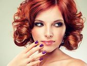 pic of hair curlers  - Beautiful model with red curly hair  - JPG
