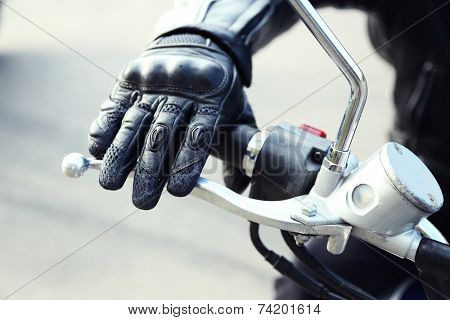 Hand rider on handlebars, close-up