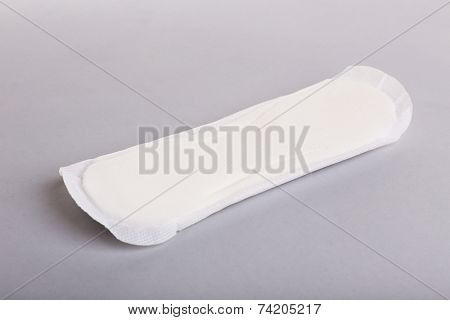 Sanitary pad on light background