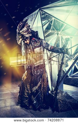 Portrait of a male shaman in ethnic dress on a background of a futuristic exterior. Fantasy concept, magic.