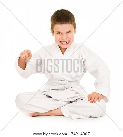 boy in white kimono for martial arts posing