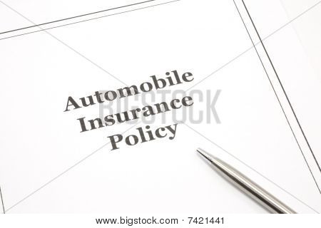 Automobile Insurance Policy With A Pen