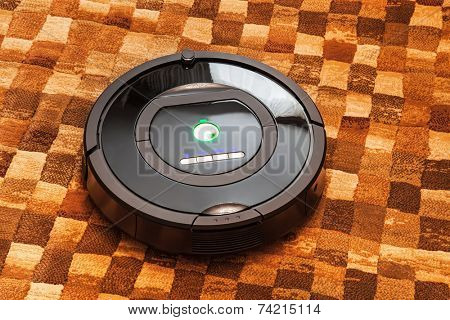 Robotic vacuum cleaner on carpet - technology housework