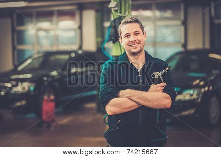Cheerful man on a car wash