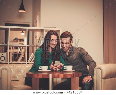 Young couple looking something in mobile phone