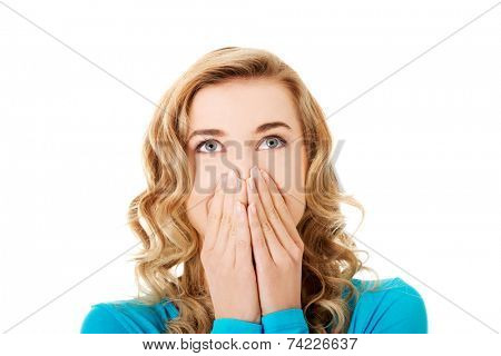 Woman giggles covering her mouth with hand