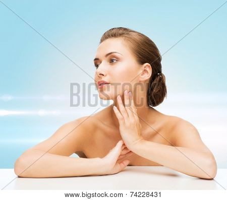 beauty, health and people concept - smiling beautiful woman with clean perfect skin over blue laser lights background