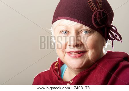 Close-up Of White-haired Woman In Maroon Hat
