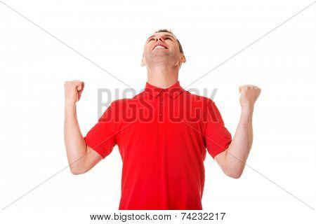Happy succesfull young man with fists up