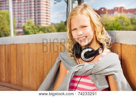 Close view of girl wearing headphones, sweatshirt