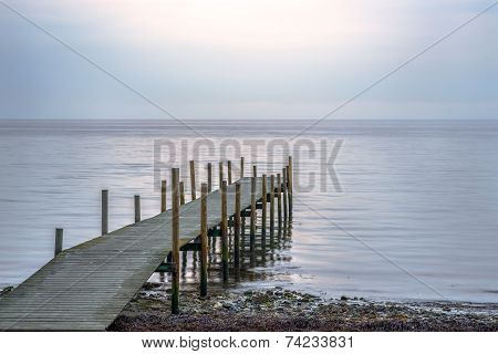 Wooden pier at beach on a calm morning