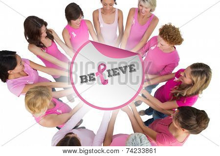 Cheerful women joined in a circle and looking at each otherwearing pink for breast cancer against breast cancer awareness message