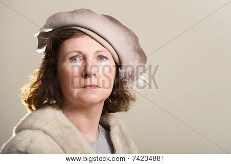 Serious Brunette In Taupe Hat And Fur