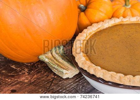 Closeup Of Pie Pumpkin And A Homemade Pumpkin Pie