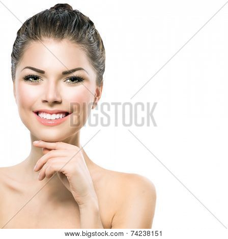 Beauty Portrait. Beautiful Spa Girl Touching her Face. Perfect Fresh Skin. Pure Beauty Model Girl. Youth and Skin Care Concept. Beauty Teenage Model Girl Portrait isolated on white background