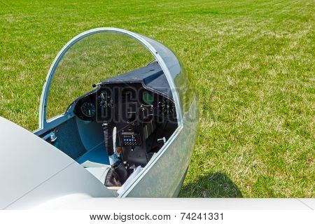 Sailplane With Opened Cockpit Hood Of Glass Resting