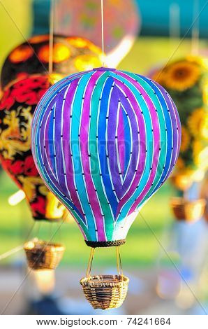 Bunch Of Hot Air Balloon Toys Dangling In The Wind