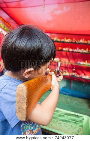 Boy using air gun