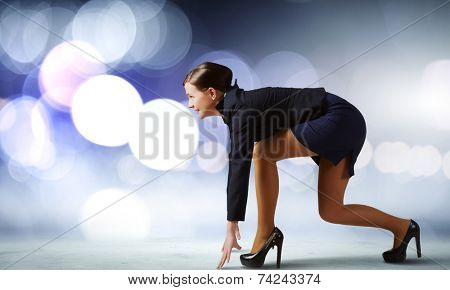 Side view of businesswoman standing in start position