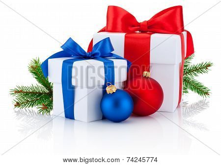 Two White Boxs Tied Red And Blue Ribbon Bow, Pine Tree Branch And Christmas Balls Isolated On White