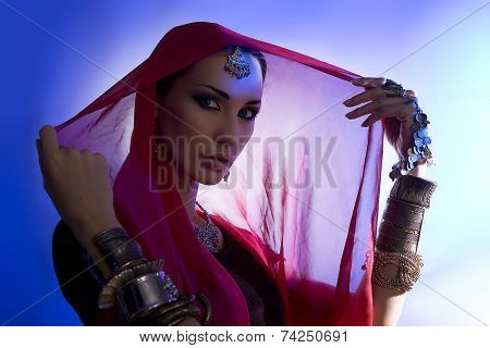Beautiful Young Indian Woman In Traditional Clothing With Bridal Makeup And Oriental Jewelry.