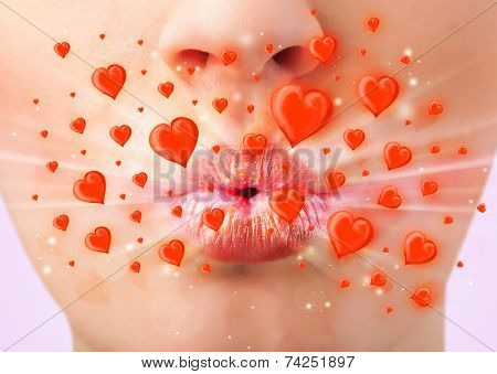 Pretty lady lips with lovely red hearts close up