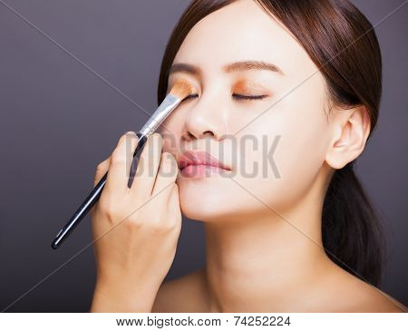 Make Up Artist Applying  Color Eyeshadow On Model's Eye
