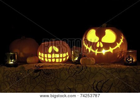 Jack o Lantern Pumpkins on Cobweb Fabric