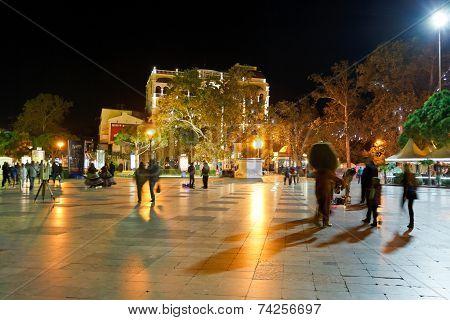 Tourists Walk On Promenade In Yalta City In Night