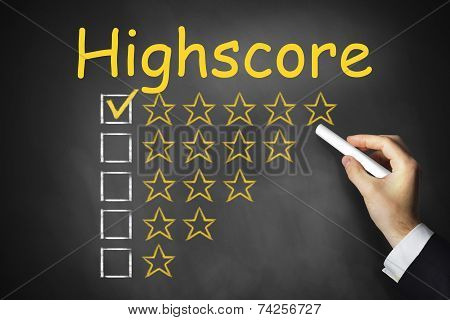Hand Writing Highscore On Black Chalkboard Rating