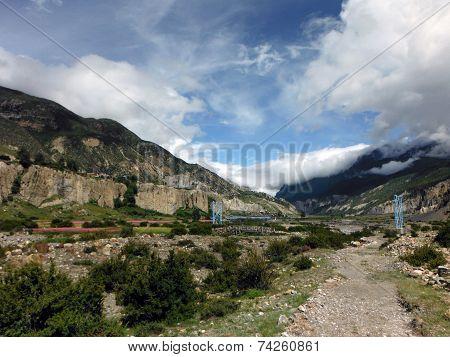 Blue Suspension Bridge In Himalayan Valley