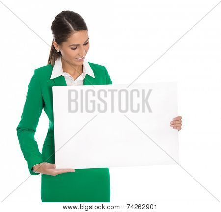 Isolated professional business woman holding white sign or billboard in her hands wearing green blazer.