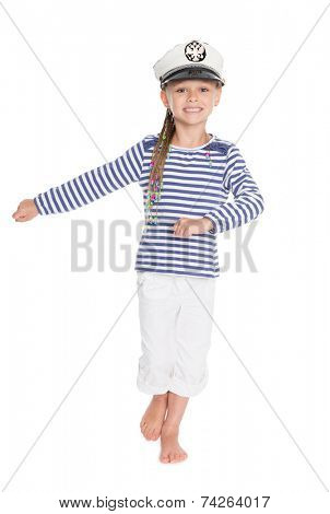 Marching mischievous girl in costume cabin boy. Girl is six years old. On her cap emblem of Russia.