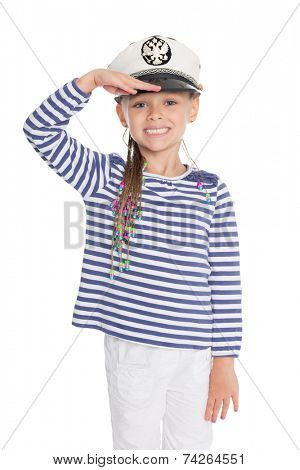 Girl dressed as a cabin boy raised his right hand in greeting. Girl is six years old. Cap has a emblem of Russia.