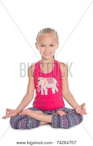 European girl sitting in the lotus position. Girl is six years old.