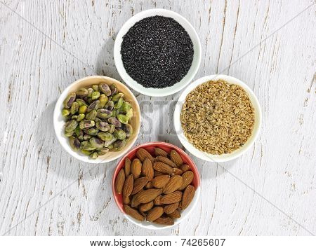 Four Bowls Of Nuts And Seeds