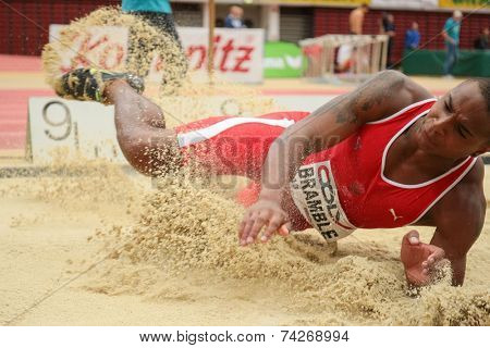 LINZ, AUSTRIA - JANUARY 30, 2014: Dan Bramble (#613 Great Britain) places 4th in the long jump team event in an indoor track and field meeting.