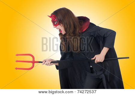Female wearing devil costume and trident