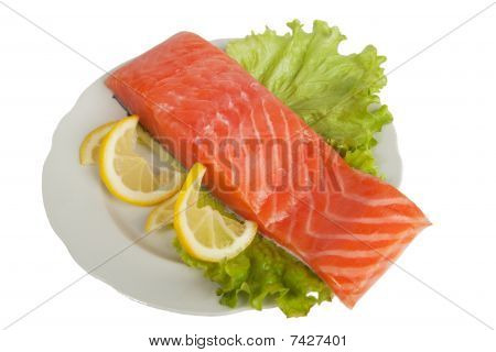 Salmon With Lemon On Salad Leaves