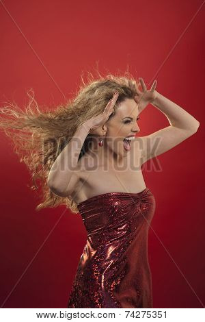 Woman With Blond Hair And Red Dress Screams
